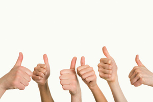 A series of hands in the thumbs up pose